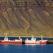 Boats at Grundarfjörður, a small fishing village situated on a beautiful bay nearly surrounded by impressive and graceful mountains. It is one of the best natural harbors on Snæfellsnes Peninsula in the West of Iceland.