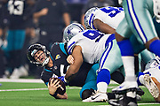 ARLINGTON, TX - OCTOBER 14:  Blake Bortles #5 of the Jacksonville Jaguars is sacked by Antwaun Woods #99 of the Dallas Cowboys at AT&T Stadium on October 14, 2018 in Arlington, Texas.  The Cowboys defeated the Jaguars 40-7.  (Photo by Wesley Hitt/Getty Images) *** Local Caption *** Blake Bortles; Antwaun Woods