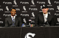 CHICAGO - DECEMBER 03:  White Sox general manager Ken Williams (l) and Adam Dunn (r) of the Chicago White Sox talk to the media during a press conference Dunn's signing with the Chicago White Sox on December 3, 2010 at U.S. Cellular Field in Chicago, Illinois.  (Photo by Ron Vesely)