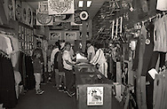A group of shoppers stand in a skateboard and surf shop during 1987 in Visalia, California.