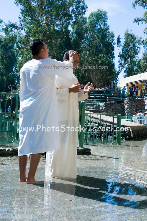Israel, Yardenit Baptismal Site In the Jordan River Near the Sea of Galilee, American pilgrim being Baptized