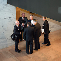 A group of lobbyists gather on the ground floor of the Hart Senate Office Building in Washington, DC between visits to various Congressional offices in April 2015.