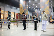 (L-R) 27 year old sailor Jaswinder Singh's son Abhimanyu Singh, brother Rigan Singh, nephew, and father Jagmal Singh wait to receive him from the Delhi airport on 29 December 2012 after his release from almost 33 months of being held hostage by Somali pirates who hijacked MV Iceberg 1, a Dubai-owned ship, off the Yemeni coast in March 2010. It was the longest-held hijacked ship until the Puntland Maritime forces released it and 22 crew members on 23 December 2012. Photo by Suzanne Lee / The National