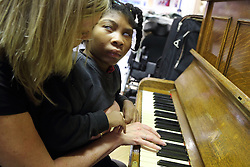 Piano lesson, Mysight Nottingham. Black visually imapired girl and teacher