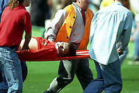 A Liverpool Fan is Stretchered away on a make shift stretcher (advertising board) to a nearby Ambulance<br />