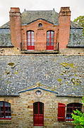 House with red doors, Mont Saint-Michel, Normandy, France