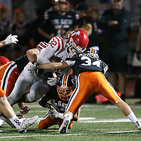 (Photograph by Bill Gerth for SVCN) Los Gatos Orange Crush defense of #34 William McCollam, #23 Mitchell McGrath, and #32 Matt Hanna tackle Saratoga #32 Ryan Caviani in a SCVAL Football Game at Los Gatos High School, Los Gatos CA on 11/4/16.  (Los Gatos 49 Saratoga 7)