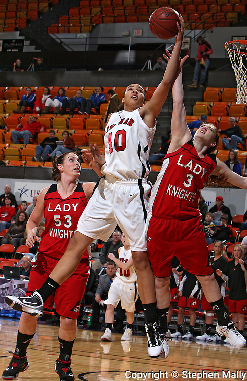 Linn-Mar's Kiah Stokes (40) and Assumption's Sam Thrapp (3) battle for a rebound as Assumption's Alyson Valainis (53) looks on during their Rivalry Saturday game at the US Cellular Center in Cedar Rapids on Saturday January 2, 2010. Linn-Mar defeated Assumption 52-48. (Stephen Mally/Freelance)