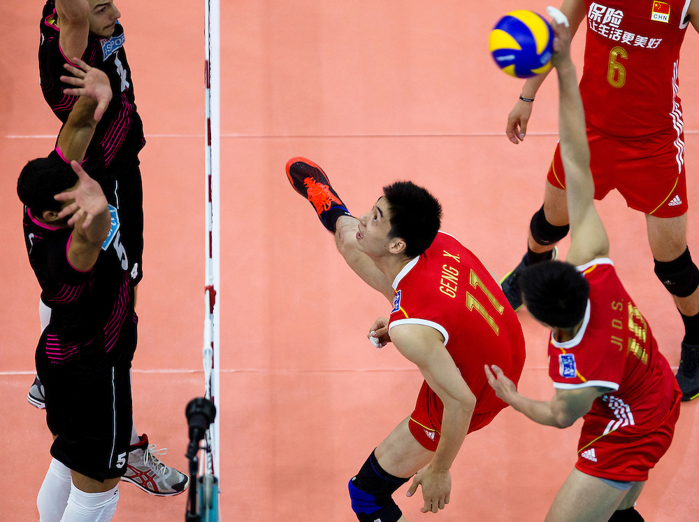 Marcel Keller Gil (1) and Marco Ferreira (5) of Portugal attempt to block Daoshuai Ji (10) of China at a World League Volleyball match at the Sasktel Centre in Saskatoon, Saskatchewan Canada on June 24, 2016.