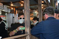Latitude Festival, Henham Park, Suffolk, UK July 2018. The dust was so bad some bar staff wore masks