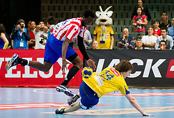 Luc Abalo of Atletico Madrid vs Sebastian Skube of Cimos Koper during 1st Leg handball match between RK Cimos Koper and BM Atletico Madrid (ESP) in Quarterfinals of EHF Champions League 2011/2012, on April 21, 2012 in Arena Bonifika, Koper, Slovenia. (Photo by Vid Ponikvar / Sportida.com)