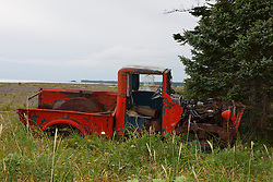 Rusted and abandoned red pick up truck, Lake Clark National Park, Alaska, United States of America