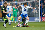 Kieron Morris of Tranmere Rovers  is tackled by Forest Green Rovers Reece Brown(10) during the EFL Sky Bet League 2 play off first leg match between Tranmere Rovers and Forest Green Rovers at Prenton Park, Birkenhead, England on 10 May 2019.