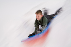 North America, United States, Washington, boy (age 10) sledding on Crystal Mountain  MR