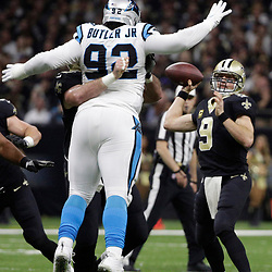 Jan 7, 2018; New Orleans, LA, USA;Carolina Panthers defensive tackle Vernon Butler (92) pressures New Orleans Saints quarterback Drew Brees (9)  during the second quarter in the NFC Wild Card playoff football game at Mercedes-Benz Superdome. Mandatory Credit: Derick E. Hingle-USA TODAY Sports