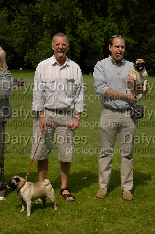 Brian Lowry and Alfie with Paul Pleasance with Barbie. LOOKALIKE COMPETITION. Pug Dog club Tea party held at Cottesbrook Hall.  ( home of  Mr. and Mrs. Alastair Macdonald-Buchanan ) 26 June 2005. . ONE TIME USE ONLY - DO NOT ARCHIVE  © Copyright Photograph by Dafydd Jones 66 Stockwell Park Rd. London SW9 0DA Tel 020 7733 0108 www.dafjones.com