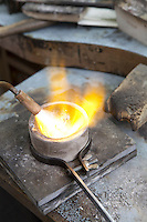 Close-up of fire torch melting jewelry in workshop