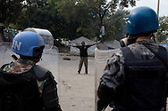 Haitian protesters, who demonstrated en masse in capital Port-au-Prince after prelimary election results were announced, attempted to broker peace between marchers and the UN peacekeepers stationed in the city.
