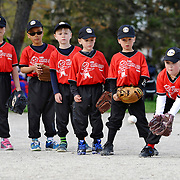 Erika Gilroy, right, watches an incoming ball during warmups with her team during Kitchener Minor Baseball action at Crosby Park on Tuesday. Registration for minor baseball is way up this year, perhaps due to the success of the Toronto Blue Jays.<br /> <br /> IAN STEWART / SPECIAL TO THE RECORD