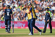 Daniel Lawrence and Aron Nijjar of Essex Eagles celebrate the wicket of Alex Hughes during the Vitality T20 Finals Day 2019 match between Derbyshire Falcons and Essex Eagles at Edgbaston, Birmingham, United Kingdom on 21 September 2019.