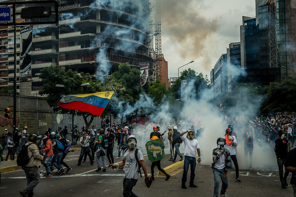CARACAS, VENEZUELA - MAY 8, 2017:  Anti-government protesters hurl stones and molotov cocktails <br />