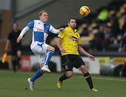 Bristol Rovers' Eliot Richards battles with Burton Albion's Phil Edwards- Photo mandatory by-line: Matt Bunn/JMP - Tel: Mobile: 07966 386802 23/11/2013 - SPORT - Football - Burton - Pirelli Stadium - Burton Albion v Bristol Rovers - Sky Bet League Two