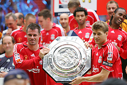 CARDIFF, WALES - SUNDAY, AUGUST 13th, 2006: Liverpool's Jamie Carragher and Steven Gerrard lift up the trophy after the Community Shield match against Chelsea at the Millennium Stadium. (Pic by David Rawcliffe/Propaganda)