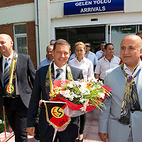 St Johnstone v Eskisehirspor....18.07.12  Uefa Cup Qualifyer<br /> Chairman Steve Brown is greeted with flowers and scarves at Eskisehir airport from Eskisehirspor Vice-President Mulla Sahbaz (right), pictured left is St J associate director Charlie Fraser<br /> Picture by Graeme Hart.<br /> Copyright Perthshire Picture Agency<br /> Tel: 01738 623350  Mobile: 07990 594431