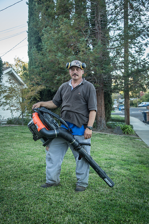 Professional gardener Mauricio Gongonzalez-Nungaray takes a break from his work on an unusually warm November evening in Martinez