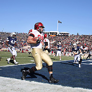 Paul Stanton, (left), Harvard, fends off Foyesade Oluokun, Yale, during his four touchdowns performance in the Yale V Harvard, Ivy League Football match at Yale Bowl. Harvard won the game 34-7 giving Harvard a share of the 2013 Ivy League title.  The game was the 130th meeting between Harvard and Yale in the historic rivalry that dates back to 1875. New Haven, Connecticut, USA. 23rd November 2013. Photo Tim Clayton
