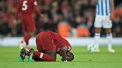 LIVERPOOL, ENGLAND - Friday, April 26, 2019: Liverpool's Sadio Mane kneels to pray as he celebrates scoring the second goal during the FA Premier League match between Liverpool FC and Huddersfield Town AFC at Anfield. (Pic by David Rawcliffe/Propaganda)