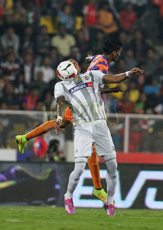 Fikru Tefera Lemessa of Atletico de Kolkata and Lenny Rodrigues of FC Pune City in action during match 44 of the Hero Indian Super League between FC Pune City and Atletico de Kolkata FC held at the Shree Shiv Chhatrapati Sports Complex Stadium, Pune, India on the 29th November 2014.<br /> <br /> Photo by:  Vipin Pawar/ ISL/ SPORTZPICS