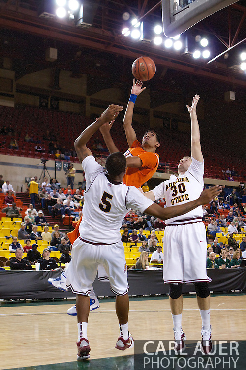 November 25th, 2010:  Anchorage, Alaska - Houston Baptist forward Andrew Gonzalez (31) draws a foul with a baby hook shot in the Huskies 55-73 loss to Arizona State at the Great Alaska Shootout.  Gonzalez led all scorers with 26 points.