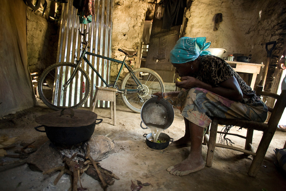 A woman cooks dinner for her family.