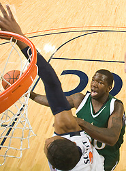 South Florida guard Dominique Jones (20) shoots over Virginia forward Mike Scott (32).  The Virginia Cavaliers defeated the South Florida Bulls 77-75 at the University of Virginia's John Paul Jones Arena in Charlottesville, VA on November 19, 2008.