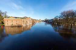 © Licensed to London News Pictures. 18/03/2019. York UK. Flooded river side properties this morning next to the river Ouse in York city centre after recent heavy rain caused overnight flooding. Photo credit: Andrew McCaren/LNP