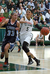 21 February 2015:  Kasey Reaber hits the paint guarded by Hannah Lipman during an NCAA women's division 3 CCIW basketball game between the Elmhurst Bluejays and the Illinois Wesleyan Titans in Shirk Center, Bloomington IL