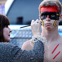 Adam Robison | BUY AT PHOTOS.DJOURNAL.COM<br /> Will Dauler, the Pontotoc Chief, has his face painted by Tami Walls before he takes to the field Friday night in Pontotoc.