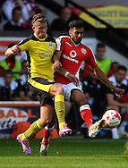 George Moncur of Colchester United looks to get past Kieron Morris of Walsall during the Sky Bet League 1 match between Walsall and Colchester United at the Banks's Stadium, Walsall<br /> Picture by Richard Blaxall/Focus Images Ltd +44 7853 364624<br /> 06/09/2014