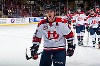 KELOWNA, CANADA - NOVEMBER 17: Tanner Nagel #18 of the Lethbridge Hurricanes skates to the bench to celebrate a first period goal against the Kelowna Rockets on November 17, 2017 at Prospera Place in Kelowna, British Columbia, Canada.  (Photo by Marissa Baecker/Shoot the Breeze)  *** Local Caption ***