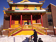A woman bicycles past the Lihn Son Tu Buddhist Temple in downtown Windsor, Canada.