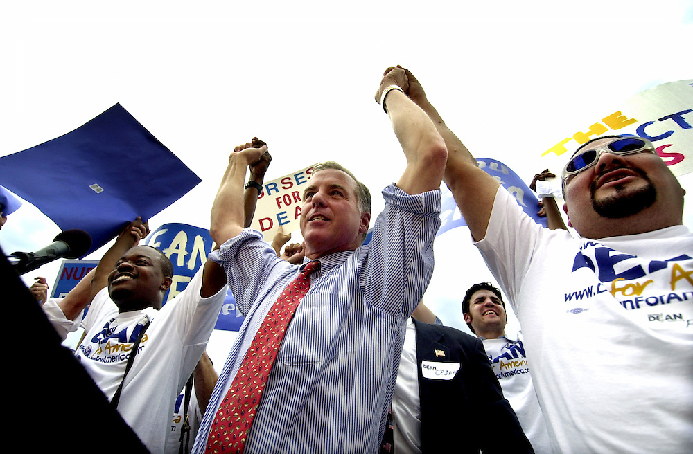 Democratic Presidential candidate and Former Gov. Howard Dean (Vt) joins hands with supporters after speaking at a rally at Navy Pier Tuesday August 26, 2003 in Chicago, Ill.  Before the rally Dean spoke to the Communication Workers of America convention at the pier.