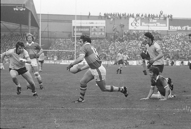 Kerry runs with ball in hands as players surround him during the All Ireland Senior Gaelic Football Final Dublin v Kerry in Croke Park on the 26th September 1976. Dublin 3-08 Kerry 0-10.