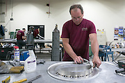 Eric Schaetzke of Honeoye works at Premier Sign Systems in Rochester on Thursday, August 27, 2015.