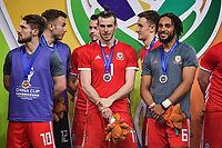 First runner-up Wales national football team take part in the award ceremony after being defeated by Uruguay national football team in their final match during the 2018 Gree China Cup International Football Championship in Nanning city, south China's Guangxi Zhuang Autonomous Region, 26 March 2018.<br /> <br /> Uruguay won the final by 1-0 against Wales and claimed the title of the event.