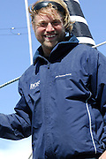 Hugo Boss skipper Alex Thomson (GBR) aboard Hugo Boss after she is docked at Chaffers marina in Wellington harbour. Barcelona World Race. 27/12/2007