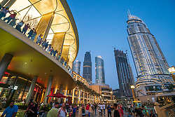 Evening crowds of people at  the Dubai Mall in Dubai, United Arab Emirates.