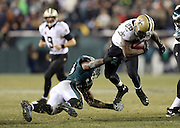 New Orleans Saints running back Khiry Robinson (29) leaps and eludes a tackle attempt by Philadelphia Eagles inside linebacker DeMeco Ryans (59) as he runs the ball late in the fourth quarter during the NFL NFC Wild Card football game against the Philadelphia Eagles on Saturday, Jan. 4, 2014 in Philadelphia. The Saints won the game 26-24. ©Paul Anthony Spinelli