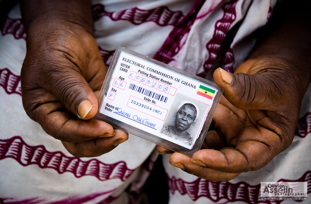 Sarah Cheetham, 66, holds her voter card while she waits to vote at a polling station in Ghana's capital Accra during presidential and parliamentary elections on Sunday December 7, 2008.