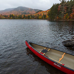 A canoe on the shore of Greenough Pond in Wentworths Location, New Hampshire. Fall. Northern Forest.